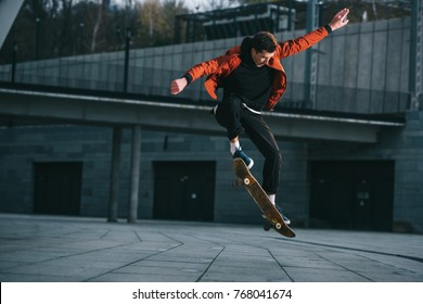 skateboarder doing jump trick in urban location