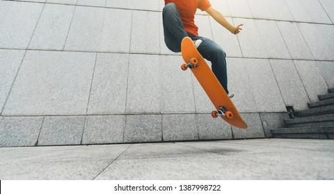 Skateboarder doing ollie at city