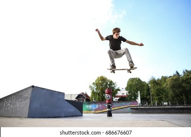 Skateboarder doing ollie from the kicker