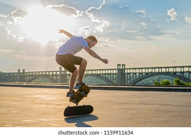 Skateboarder doing a trick in a jump at sunset. Active lifestyle.