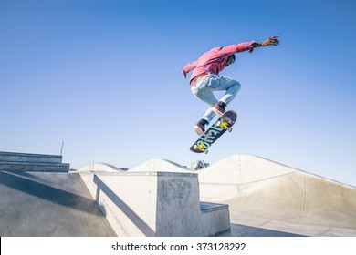 Skateboarder doing a trick in a skate park
