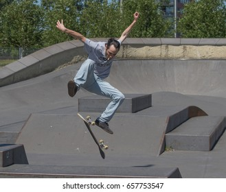 A skateboarder executing a kickflip in the air