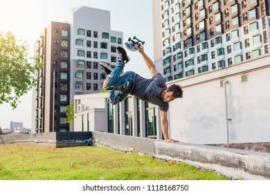 Skateboarder handstand on ramp on the sunset.