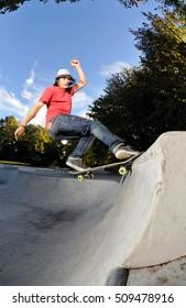 skateboarder having fun at the local skate park