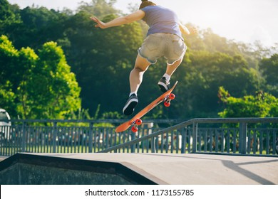 Skateboarder jumping in the skatepark