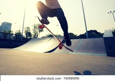 skateboarder legs skateboarding on skatepark