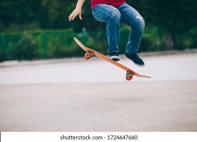 Skateboarder legs skateboarding at outdoors
