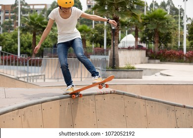 Skateboarder on skatepark ramp