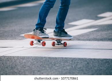 Skateboarder sakteboarding on city highway