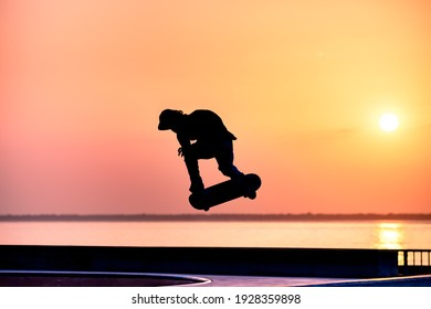 skateboarder silhouette jumping in skatepark