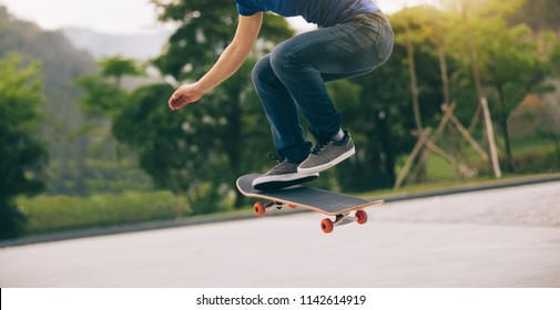 Skateboarder  skateboarding  on parking lot