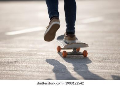 Skateboarder skateboarding outdoors on sunny morning