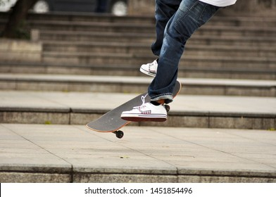 Skateboarder skateboarding in the park. Skater in action. Outdoor sport activity. Energetic boy skating.
