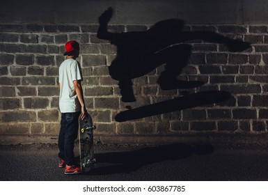 Skateboarder standing there, looking at own shadow caught in middle of stunt from past. Interesting and unusual montage is expressing a lot of different ways, which has wide range of possible uses.