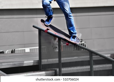 Skateboarding as extreme and fun sport, trick in a city skate park.
