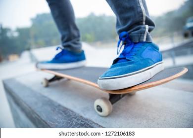 skateboarding legs riding skateboard at skatepark