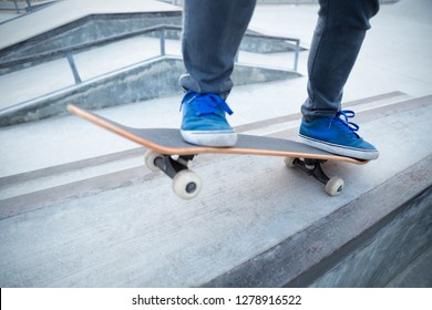skateboarding legs riding skateboard at skatepark