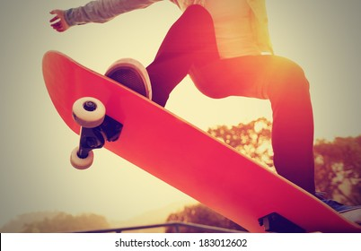 skateboarding woman sunrise