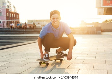 Skater Boy Riding on Skateboard in Skate Park Outdoor. Skateboarding is popular fun extreme sport for young active people. Teen lifestyle