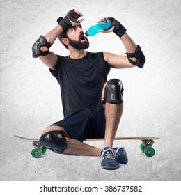 Skater drinking water