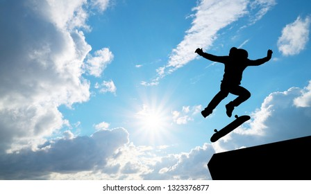 Skater jump silhouette and blue sky. Element of design.