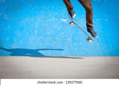 Skater jumps high in air under extrem-park