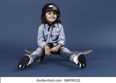 Skater kid in blue studio, portrait