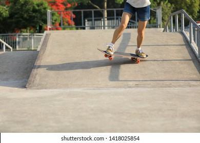 skater legs skating at skatepark
