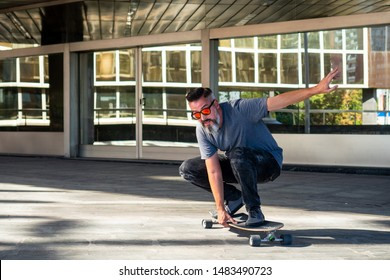 Skater riding a skateboard. Building in the background