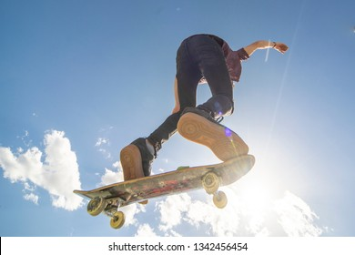 skater with skateboard doing trick