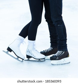 Skates. Couple on the ice rink