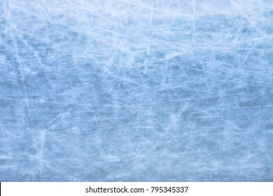 Skating ice rink texture covered in daylight /Close up of blue ice rink floor, copy space/ Perfectly polished artificial ice