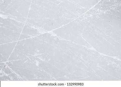 Skating scratches on the ice surface of the lake in winter