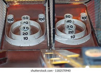 Skee ball at an amusement part