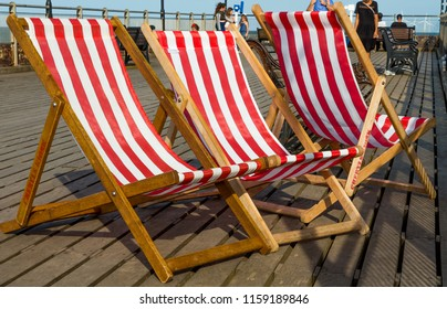 SKEGNESS, LINCOLNSHIRE, ENGLAND, AUGUST 1, 2018. Scene on Skegness Pier with hired Deck Chairs and holiday makers. August 1, 2018, Skegness, Lincolnshire, England, UK.