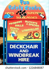Skegness, Lincolnshire, UK. July 15, 2014.   A colorful end of shelter advertisement with beach essentials on the seafront at Skegness in Lincolnshire, UK.