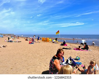 Skegness, Lincolnshire, UK. July 16, 2014.  Families of Holidaymakers enjoying a summer day on the beach at Skegness in Lincolnshire, UK.