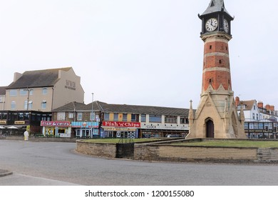 Skegness, Lincolnshire, UK. October 05, 2018.  The clock tower built in 1898 to commemorate Queen Victoria's diamond jubilee is a landmark at the end of the town of Skegness in Lincolnshire, UK.