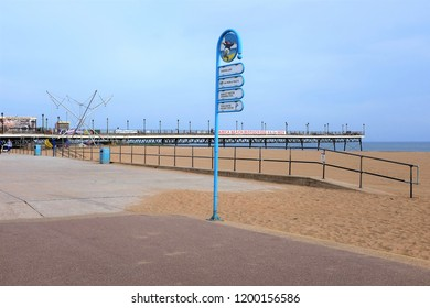 Skegness, Lincolnshire, UK. October 05, 2018.  A municipal Information sign with the pier in the background on the promenade at Skegness in Lincolnshire, UK.