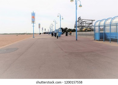 Skegness, Lincolnshire, UK. October 05, 2018. Holidaymakers enjoying a empty October promenade and beach at Skegness in Lincolnshire, UK.