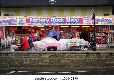 Skegness,Lincolnshire,UK:  August 05th 2018.Holiday makers make the most of a bad day with summer rain storm at the Lincolnshire seaside resort of Skegness.