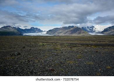 Skeidararsandur with   view to Vatnajokull glacier and mountains, Iceland in summer