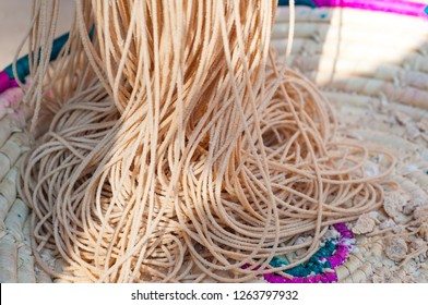 A skein of brown wheat flour noodles