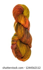 A skein of colored threads for knitting from wool isolated on a white background. View from above.
