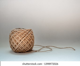 Skein of jute twine isolated on white background with copy space. Roll of natural jute rope.