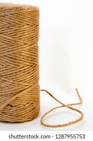 A skein of natural jute twine against a light background