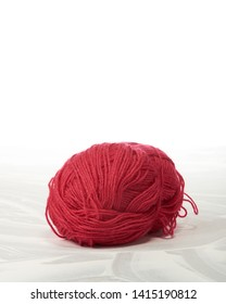Skein of red wool thread on a white background