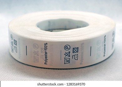 Skein tags for clothing, satin ribbon with symbols for the use of clothing. Labels that are sewn to the inside of the garment.