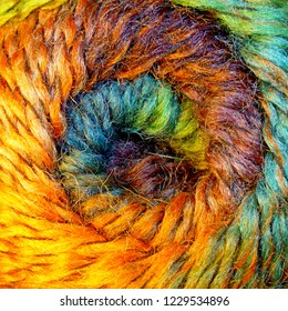 Skein of wool yarn. Macro shooting. Texture of wavy thread. Background image. Hobbies leisure crafts