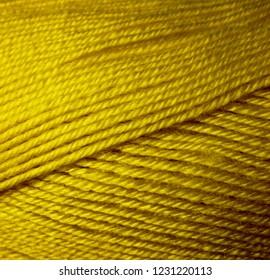 Skein of wool yarn. Macro shooting. Texture of wavy thread. Yellow green threads. Background image. Hobbies leisure crafts